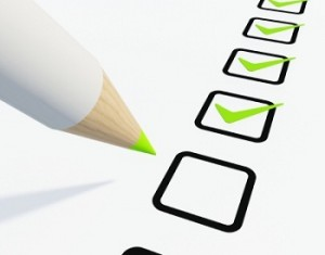 Checklist with pen isolated on white
